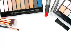 Makeup brush set with eye shadow palette on white Royalty Free Stock Image