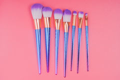Makeup brush set on red pink pastel background Stock Photography
