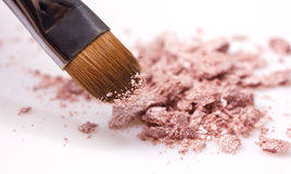 Makeup brush and shadows stock images