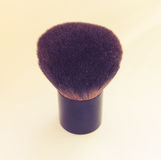 Makeup brush on white background. Brush for applying powder of natural cloth Royalty Free Stock Photo