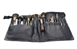 Makeup brushes. In pouch isolated on white Stock Photography