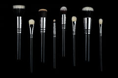 Makeup brushes on black background. Makeup brushes lying on a black background Stock Photography