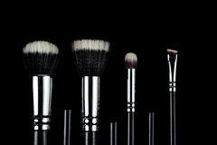 Makeup brushes on black background. Makeup brushes lying on a black background Stock Image