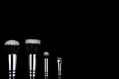 Makeup brushes on black background. Makeup brushes lying on a black background Royalty Free Stock Photo