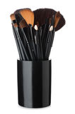 Makeup brushes in black ceramic cup Stock Photography