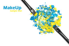 Makeup brushes with blue and yellow eyeshadow Royalty Free Stock Images