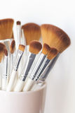 Makeup brushes. Close up of makeup brushes in a pink cup Royalty Free Stock Images