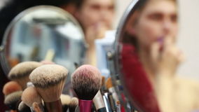 Makeup brushes, closeup. Reflection in the mirror. make-model stock video footage