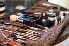 makeup brushes, closeup, set of brushes for makeup scattered chaotically,makeup concept stock photo