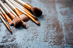 Makeup brushes collection, new make-up tools set on painted back Royalty Free Stock Photos