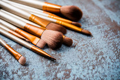 Makeup brushes collection, new make-up tools set on painted back Royalty Free Stock Photo