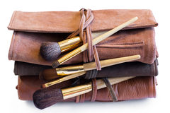 Makeup Brushes in a colored leather coveres Royalty Free Stock Photography