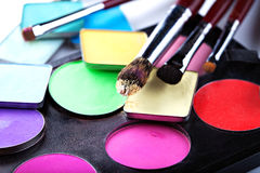 Makeup brushes with colorful eyeshadows, close-up Royalty Free Stock Image