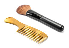 Makeup brushes  and comb Royalty Free Stock Images