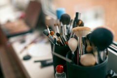 Makeup brushes and cosmetics. On the background Stock Photography