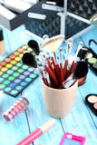 Makeup brushes and cosmetics Stock Images