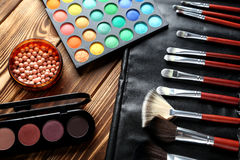 Makeup brushes and cosmetics Stock Photography