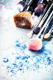 Makeup brushes and crushed eyeshadow Royalty Free Stock Images