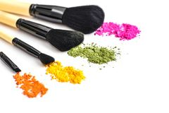 Makeup brushes and crushed eyeshadow Stock Images
