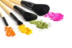 Makeup brushes and crushed eyeshadow Royalty Free Stock Photo