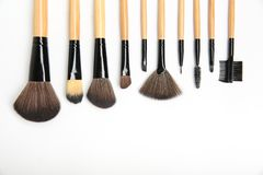 Makeup brushes of different shapes and sizes on a white background stock image
