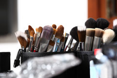 Makeup brushes, in dressing room mirror closeup Stock Photo