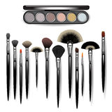 Makeup brushes and eye shadow Royalty Free Stock Photography