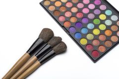 Makeup brushes and eye shadow, on white isolated background. The concept of makeup royalty free stock photo