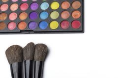 Makeup brushes and eye shadow, on white isolated background. The concept of makeup royalty free stock photography