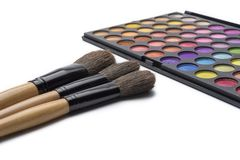 Makeup brushes and eye shadow, on white isolated background. The concept of makeup royalty free stock images