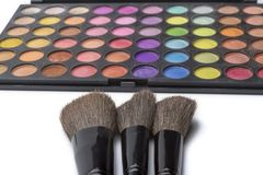 Makeup brushes and eye shadow, on white isolated background. The concept of makeup stock image