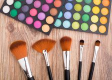 Makeup brushes and eye shadows Stock Image