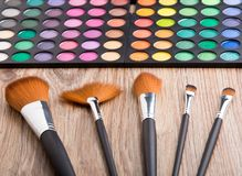Makeup brushes and eye shadows Royalty Free Stock Photos