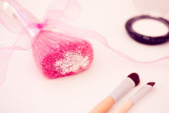 Makeup brushes and eyeshadow Royalty Free Stock Photography