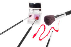 Makeup brushes with eyeshadow and gloss Stock Photography
