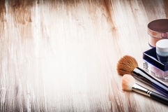 Makeup brushes and face powder. With copyspace stock photos