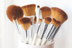 Makeup brushes horizontal. Horizontal image of makeup brushes in a pink cup Stock Photography