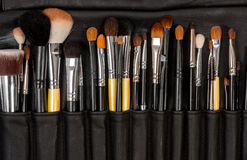 Makeup brushes in leather Stock Photos