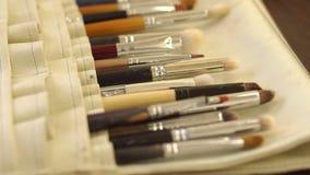 Various makeup brush set close-up.Makeup brush set. Makeup brushes in leather case. Various makeup brush set close-up. Makeup brush set stock video