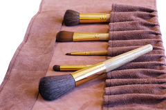 Makeup Brushes in a leather cover Royalty Free Stock Photography
