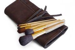 Makeup brushes on a leather cover Royalty Free Stock Images
