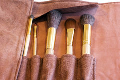 Makeup Brushes in a leather cover Stock Photography