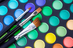 Makeup brushes and make-up eye shadows Stock Image