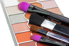 Makeup brushes and make-up eye shadows Stock Photos