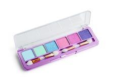Makeup brushes and make-up eye shadows Royalty Free Stock Image