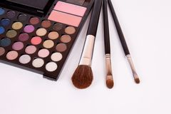 Makeup brushes and make-up eye shadows with blush Stock Image