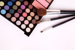 Makeup brushes and make-up eye shadows with blush Royalty Free Stock Photography