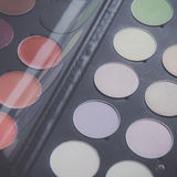 Makeup brushes and make-up eye shadows on desk Royalty Free Stock Photo