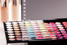 Makeup brushes and make-up eye shadows Stock Images
