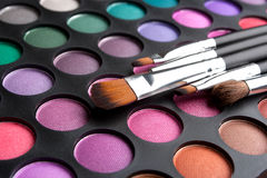 Makeup brushes and shadows Royalty Free Stock Photos